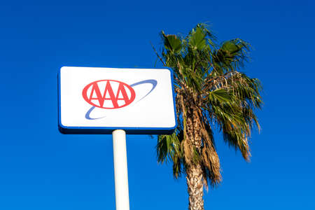 AAA sign at a branch of American Automobile Association privately held not-for-profit national member association and service organization - San Jose, California, USA - 2019