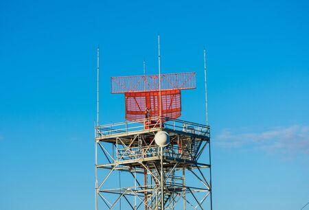 Airport surveillance radar, ASR, a radar system used at airports. A bright blue sky background