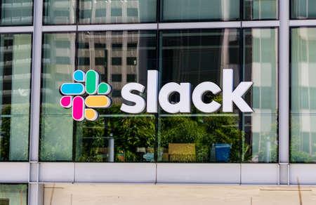 Slack sign and logo on facade of software company headquarters building - San Francisco, California, USA - 2019 Editorial