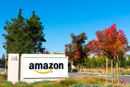 Amazon logo with its signature orange smile on signpost at Silicon Valley campus - Sunnyvale, California, USA - 2019