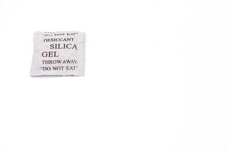 Silica gel paper packet with do not eat warning. White background.