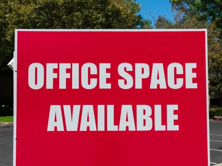 Office Space Available - large sign near commercial vacant building advertising the real estate, property, office for sale, rent or lease.