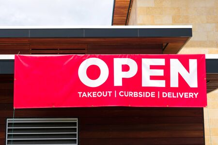 Open for takeout, curbside and delivery outdoor advertisement banner.