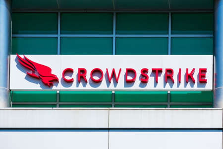 CrowdStrike sign and logo at headquarters in Silicon Valley. CrowdStrike Holdings, Inc. is a public cybersecurity technology company - Sunnyvale, California, USA - 2020 Editorial