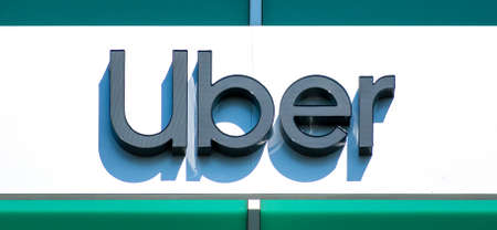 Uber sign and logo at offices in Silicon Valley. San Francisco based Uber Technologies is an American multinational ride-hailing company - Sunnyvale, California, USA - 2020 Editorial