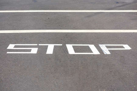 Temporarily STOP warning traffic sign painted on street surface.