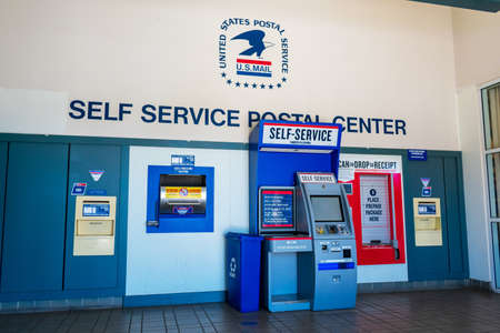 USPS self service postal center with self service kiosk and collection boxes located inside United States Post office - Cupertino, California, USA - 2018