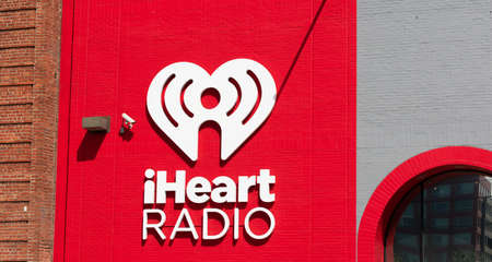 iHeart Radio sign and logo on company office facade. iHeartRadio is a free broadcast and internet radio platform owned by iHeartMedia - San Francisco, California, USA - 2019