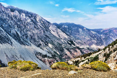 Scenic view of Tioga Pass road passing Lee Vining Creek Canyon on summer day.