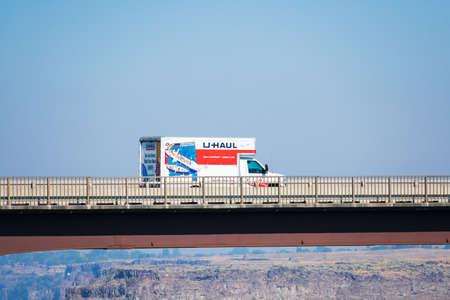 U-Haul moving truck is travelling on Perrine Memorial bridge. U-Haul is an American moving equipment and storage rental company - Twin Falls, Idaho, USA - 2020