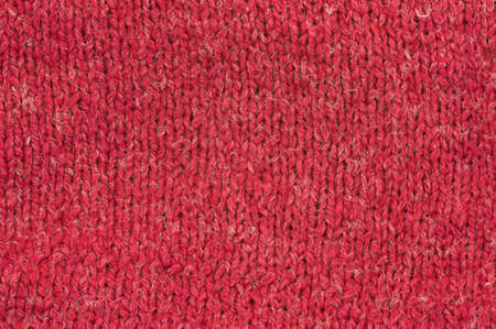 Red Wool knitting texture, close-up photo