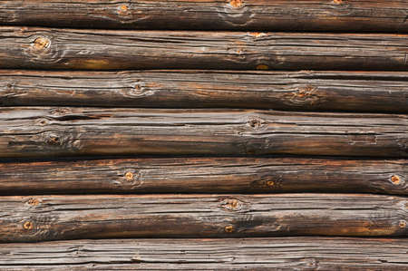 Fragment of old wooded wall from logs, background photo