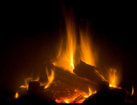 wood fire: Flame of fireplace with black background Stock Photo