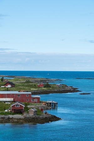Summer houses next to the sea used for fishing at the Lofoten Islands in Norway Stok Fotoğraf