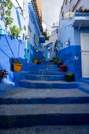 A blue staircase in the streets of Chefchaouen, Morocco Standard-Bild - 120447553