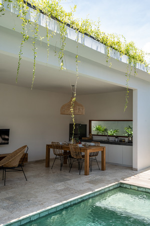 LOMBOK, INDONESIA - February  11 2019: A beautiful private dining area in the Kumbara villa in Kuta on the island of Lombok showing some wine bottles and a kitchen Editorial
