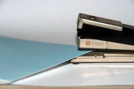 A stapler with some sheets to staple photo