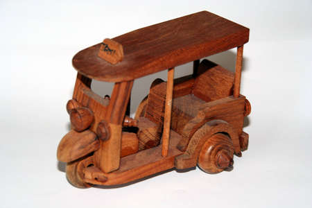 A Thai Taxi made of wood photo