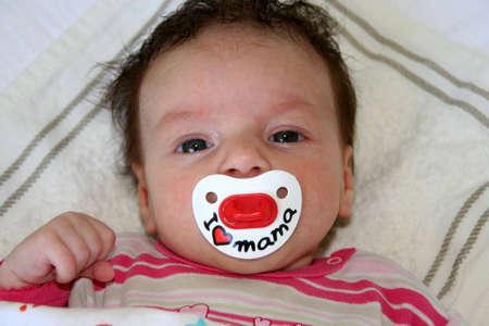 mamma: A baby who adores mama Stock Photo
