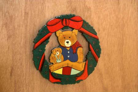 teddy wreath: A teddybear sitting in a wreath