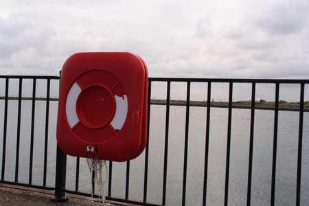 life saving: A life saving buoy at the shore
