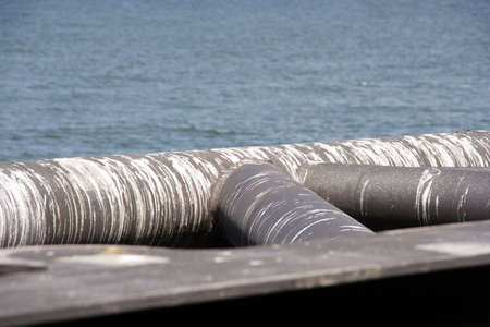 excretion: Dirty pipes, on the seashore, covered with gull-poop