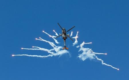 air demonstration: An Apache performing an airshow Editorial