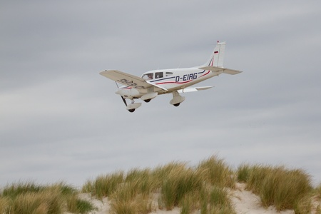 Small plane on approach at the airport on Dune (Helgoland)