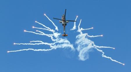 leeuwarden: LEEUWARDEN,FRIESLAND,HOLLAND-SEPTEMBER 17:: Apache AH-64D Solo Display Team shoots flares at the Airshow on September 17, 2011 at Leeuwarden Airfield, Friesland, Holland.