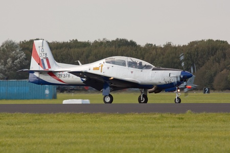 LEEUWARDEN,FRIESLAND,HOLLAND-SEPTEMBER 17: Embraer EMB 312 Tucano airplane at the dutch Airshow on September 17, 2011 at Leeuwarden Airfield,Friesland,Holland Stock Photo - 12690052
