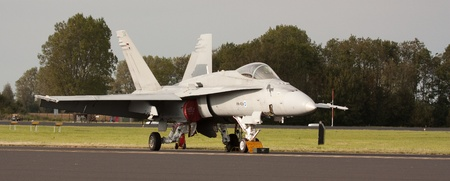 f18: LEEUWARDEN,FRIESLAND,HOLLAND-SEPTEMBER 17: A Finish Karelia Air Command F-18 at the Airshow on September 17, 2011 at Leeuwarden Airfield