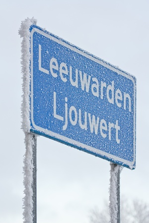 covert: A sign of the dutch city of Leeuwarden is covert in hoarfrost