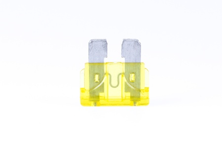 car fuse: A yellow car fuse with a white background