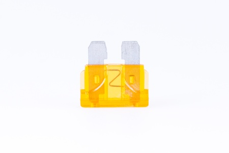 car fuse: An orange car fuse with a white background Stock Photo