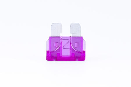 purple car: A purple car fuse with a white background