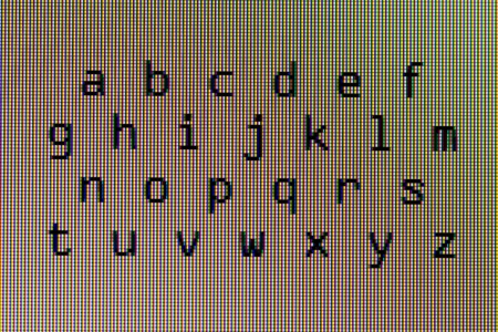 The alphabet in close-up on a computer screen (white) photo