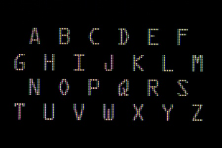 The alphabet in close-up on a computer screen (black)