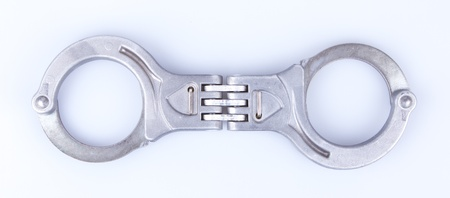 Metal handcuffs isolated on a grey background Stock Photo - 13145121