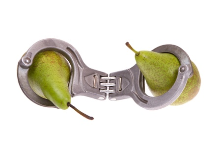 fall arrest: Pears caught in handcuffs on a white background