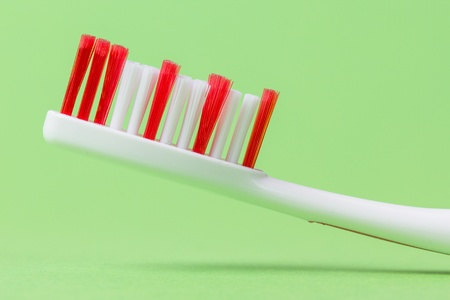 A pink toothbrush on a green background Stock Photo - 13348223