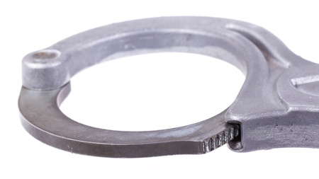 A close-up of metal handcuffs isolated on a white background Stock Photo - 13348242