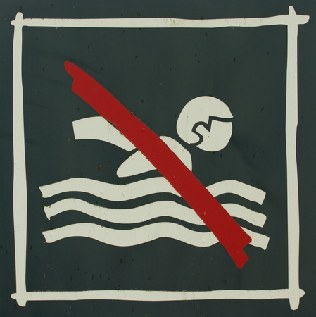 A close-up of a no swimming sign Stock Photo