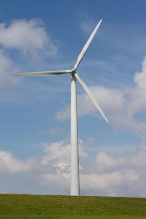 Close up of Wind turbine producing alternative energy on a dutch dike photo