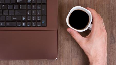 Coffee on wood floor with a laptop Stock Photo - 13552721