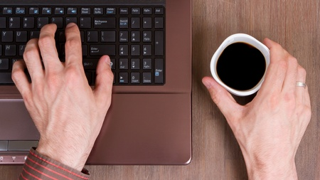 Coffee on wood floor with a laptop Stock Photo - 13552754