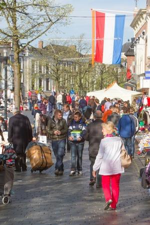 beatrix: LEEUWARDEN,FRIESLAND,HOLLAND-APRIL 30: A typical dutch flea market on Queens Day on April 30, 2012 at Leeuwarden,Friesland,Holland
