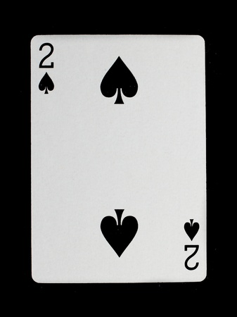 spade: Old playing card (two) isolated on a black background