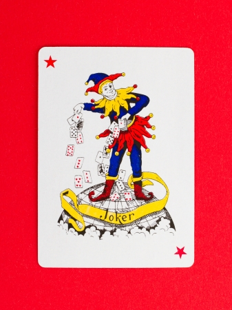 Playing card (joker) isolated on a red background