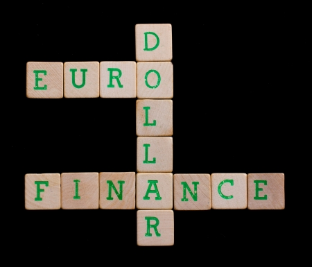 Letters on wooden blocks (euro, dollar, finance) Stock Photo - 13661073