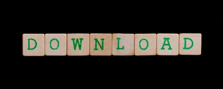 Green letters on old wooden blocks (download) photo